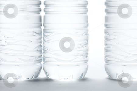 Water Bottles Abstract stock photo, Water Bottles Abstract Image on a Gradated White Background. by Andy Dean