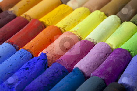 Pastel crayons abstract stock photo, A macro of soft artist pastel crayons with vibrant blue, red, green, yellow colors by Marek Uliasz