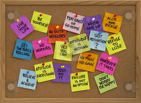 Motivational reminders on bulletin board stock photo, Motivational slogans and phrases - colorful reminder notes with handwriting on cork bulletin board by Marek Uliasz