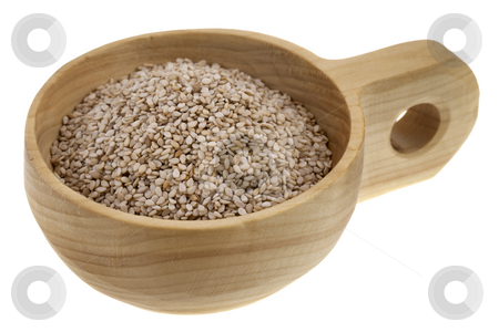Unhulled sesame seeds stock photo, Unhulled sesame seeds in a rustic wooden bowl (scoop) isolated on white by Marek Uliasz