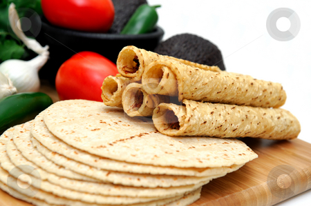 Taquito Closeup stock photo, Taquitos with other natural ingredients including homemade tortillas, avocados, tomatoes, small sweet onions and jalapeno chilies by Lynn Bendickson