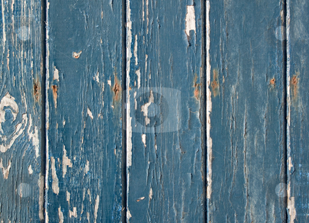Blue flaky paint on a wooden fence. stock photo, Blue flaky paint on a wooden fence. by Stephen Rees