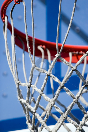 Basketball Hoop and Net stock photo, Closeup detail of a playground basketball goal and net. Shallow depth of field. by Todd Arena