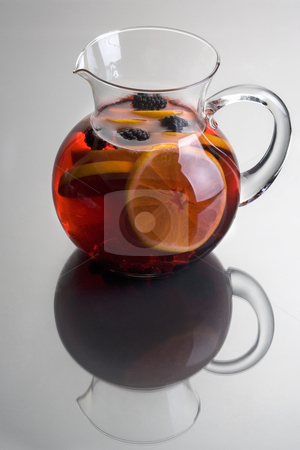 Red Wine Sangria stock photo, Pitcher of Red Sangria with aranges and blackberries on grey background close up by Gabe Palmer