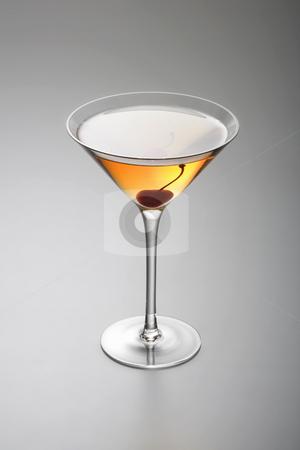 Rob Roy or Manhattan cocktail stock photo, Rob Roy or Manhattan mixed drink  with cherry garnish  on grey background by Gabe Palmer