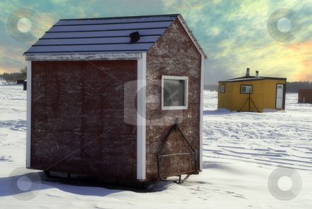 Ice Shed stock photo, Temporary shacks used for ice fishing situated on the frozen