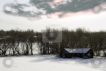 Winter Cabin stock photo, A winter cabin surrounded by trees and snow on a partly cloudy day. by Richard Nelson