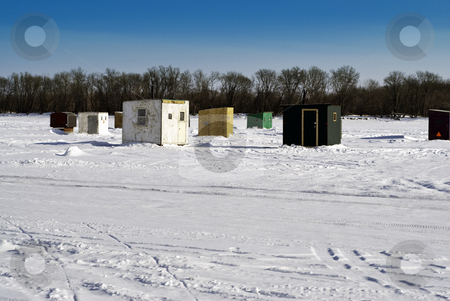 Ice Fishing Houses stock photo, Scattered shacks used for ice fishing situated on the frozen