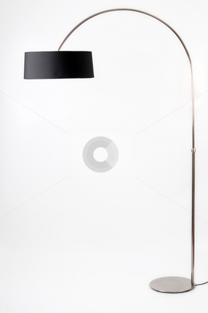Floor lamp. Isolated on white background stock photo, Contemporary metallic and black floor lamp on white background by Cienpies Design