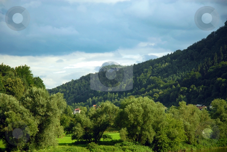 Landscape of houses in a green mountain forest stock photo, Green mountain forest. Czech Republic by Cienpies Design