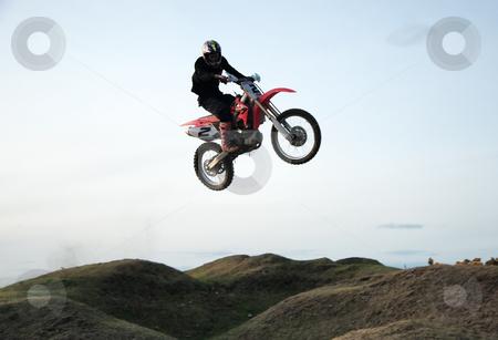 Motor cross rider stock photo, Motor cross rider jumping through the air by Viv Van der Holst