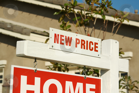New Price Real Estate Sign & New Home stock photo, New Price Real Estate Sign in Front of Beautiful New Home. by Andy Dean