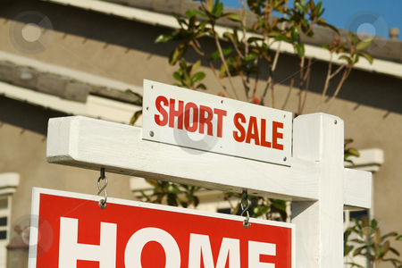 Short Sale Real Estate Sign & New Home stock photo, Short Sale Real Estate Sign in Front of Beautiful New Home. by Andy Dean