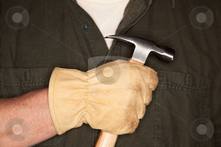 Man with Leather Construction Glove Holding Hammer stock photo, Caucasian Man with Leather Construction Glove Holding Hammer. by Andy Dean
