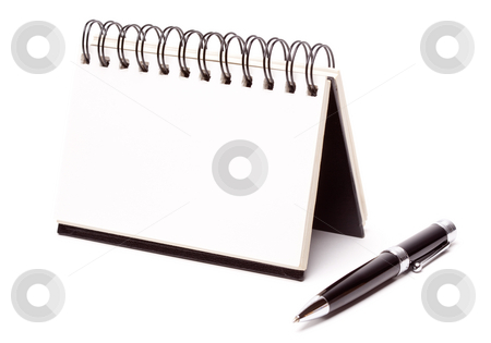 Blank Spiral Note Pad and Pen on White stock photo, Blank Spiral Note Pad and Pen Isolated on White. by Andy Dean
