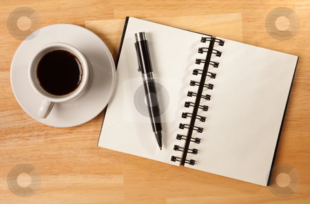 Blank Spiral Note Pad, Cup and Pen on Wood stock photo, Blank Spiral Note Pad, Cup of Coffee and Pen on Wood Background. by Andy Dean
