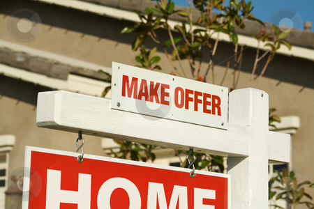 Make Offer Real Estate Sign & New Home stock photo, Make Offer Real Estate Sign in Front of Beautiful New Home. by Andy Dean