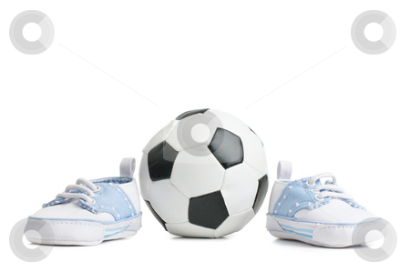 Football / Soccer Ball With Baby Shoes stock photo, A football / soccer ball with baby shoes, on white. by Christopher Nuzzaco
