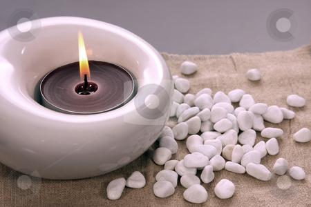 Candles and massage stones in a calm zen spa stock photo, Candles and massage stones in a calm zen spas by Jorge Casais