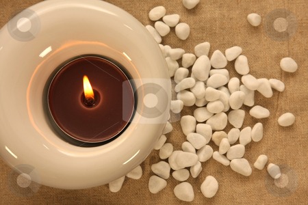Candles and massage stones in a calm zen spa stock photo, Candles and massage stones in a calm zen spas by Jorge Casais