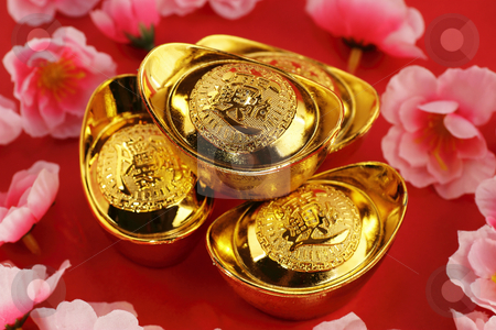 Chinese gold ingots stock photo, Top view of some chinese gold ingots surrounded by cherry blossoms on a red background by Adrin Shamsudin