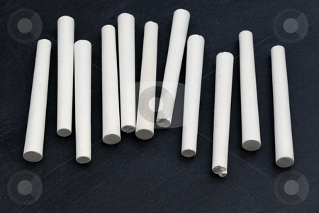 White chalk and balckboard stock photo, Several white chalk sticks on blackboard background by Marek Uliasz