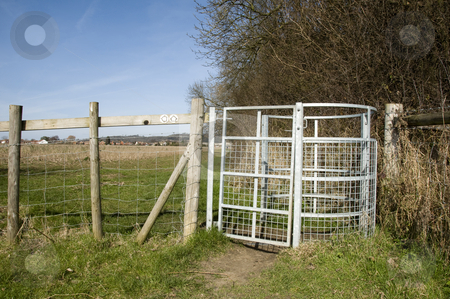 Farm gate stock photo, A metal farm gate with fields in the background by Mark Bond