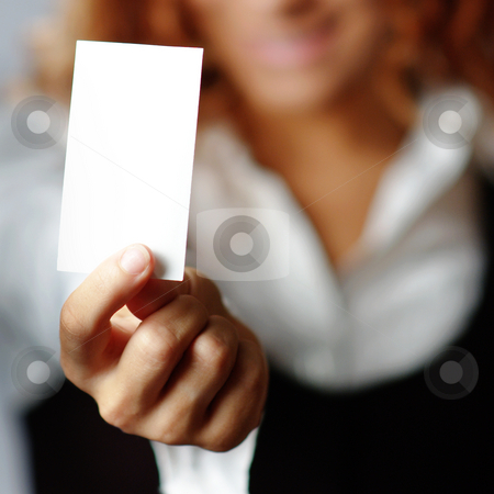 Pretty Girl Holding Blank Media stock photo, Pretty girl holding white blank media, against white. by Christopher Nuzzaco
