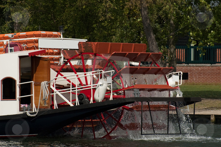 Riverboat paddles stock photo, Movement of water by riverboat paddle wheel by Steve Mann
