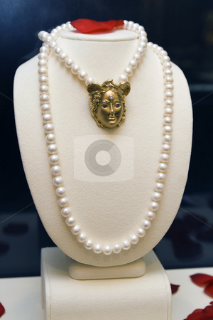 Pearls and Broach stock photo, Pearl on display at a jewelry store by Bill Swiger