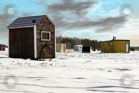 Ice Fishing Shed stock photo, Temporary shacks used for ice fishing situated on the frozen