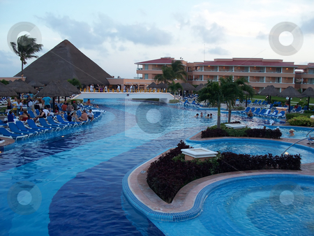 Poolside stock photo, A beautiful poolside resort in Cancun Mexico by CHERYL LAFOND