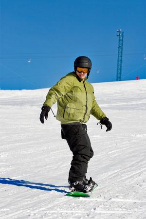 Snowboarder portrait stock photo, Portrait of a boy snowboarding by Nikola Spasenoski