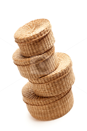 Stack of Wicker Baskets on White stock photo, Stack of Various Sized Wicker Baskets Isolated on White. by Andy Dean