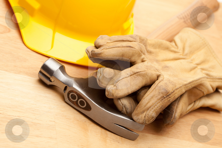 Yellow Hard Hat, Gloves and Hammer on Wood stock photo, Yellow Hard Hat, Gloves and Hammer on Wood Surface. by Andy Dean