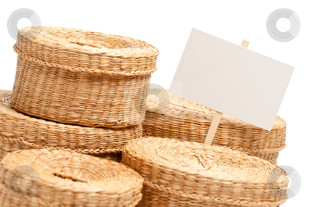 Various Sized Wicker Baskets with Blank Sign on White stock photo, Various Sized Wicker Baskets with Blank Sign Isolated on White. by Andy Dean