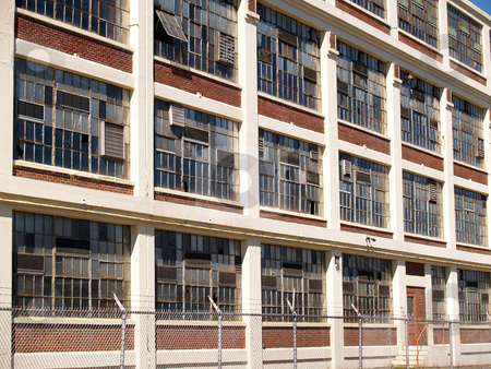 Old factory stock photo, Many windows on an old factory building by Cynthia Farmer