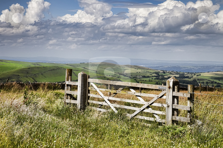 Farm gate stock photo, A farmer's gate with agricultural landscape. by Norma Cornes