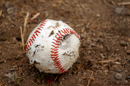 Old baseball stock photo, Old red and white rugged baseball on a dirt ground by Henrik Lehnerer