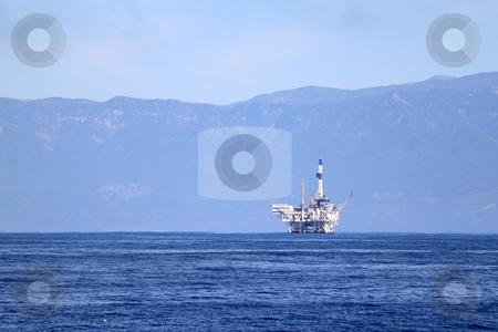 Oil rig stock photo, An offshore oil drilling platform near Ventura California by Henrik Lehnerer
