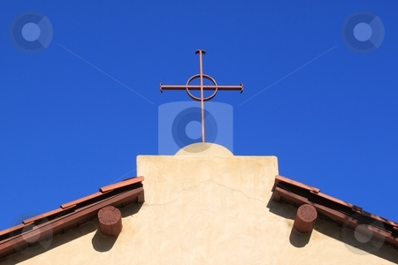 Church Cross stock photo, Church top with a cross and blue sky in the background by Henrik Lehnerer