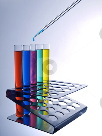 Test tubes and pipette stock photo, Close up of test tubes filled with color liquids and a pipette. by Ignacio Gonzalez Prado