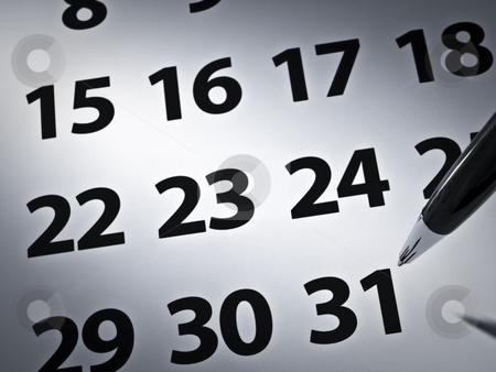 Pen and calendar stock photo, Close up on a pen ready to write on a calendar. by Ignacio Gonzalez Prado