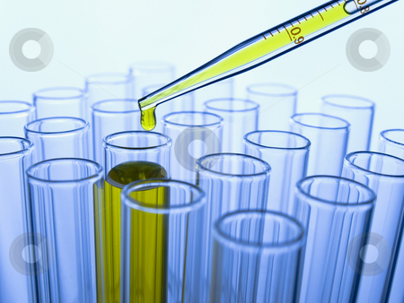 Test tubes and pipette stock photo, Close up of test tubes and pipette with a yellow liquid. by Ignacio Gonzalez Prado
