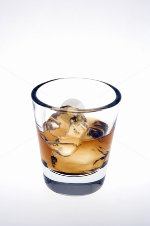 Whiskey on the rocks on a white background stock photo, Whiskey on the rocks in an empty old fashioned glass on a white background by Gabe Palmer