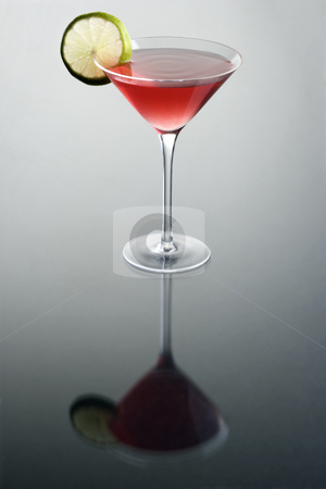 Cosmopolitan cocktail stock photo, Cosmopolitan cocktail with lime slice on grey background by Gabe Palmer