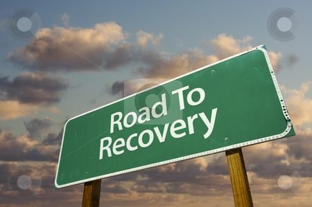 Road To Recovery Green Road Sign stock photo, Road To Recovery Green Road Sign with dramatic clouds and sky. by Andy Dean