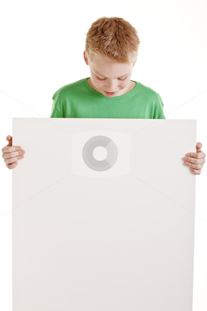 Happy boy with the empty blank sign isolated on white stock photo, Portrait of happy boy with the empty blank sign isolated on white by Jan Andersen
