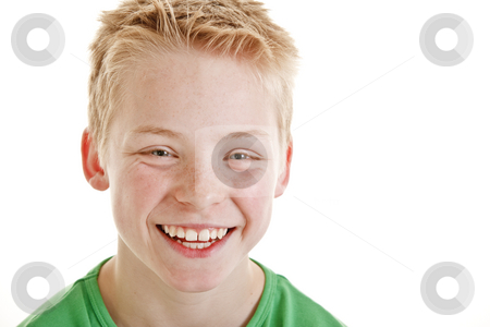 Happy smiling 12 year old boy isolated on white background stock photo, Portrait of happy smiling 12 year old boy isolated on white background by Jan Andersen