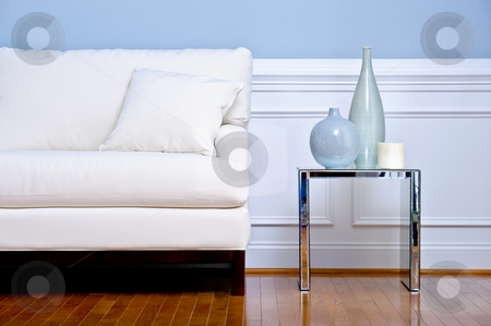 Living Room Interior stock photo, Cropped view of white couch and side table with vases, in a living room with a wood floor. Horizontal format. by Christopher Nuzzaco